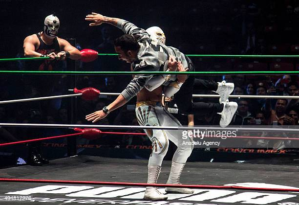 Lewis Hamilton of Great Britain and team Mercedes pretends to fight with Mexican 'Lucha Libre' wrestler Mistico during a promotional event in Mexico...