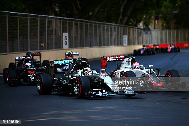 Lewis Hamilton of Great Britain drives the 4 Mercedes AMG Petronas F1 Team Mercedes F1 WO7 Mercedes PU106C Hybrid turbo next to Romain Grosjean of...