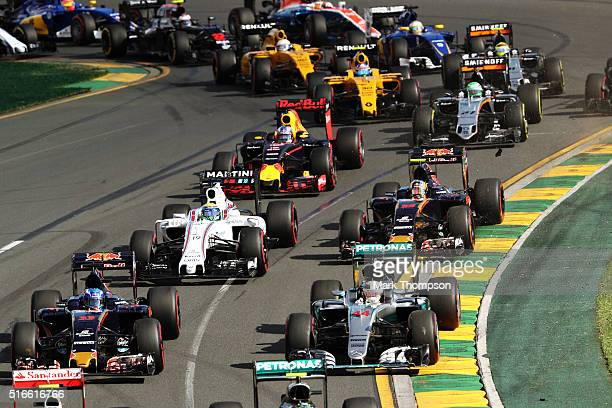 Lewis Hamilton of Great Britain drives the Mercedes AMG Petronas F1 Team Mercedes F1 WO7 Mercedes PU106C Hybrid turbo with Max Verstappen of the...