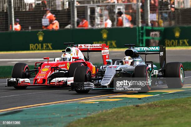 Lewis Hamilton of Great Britain drives the Mercedes AMG Petronas F1 Team Mercedes F1 WO7 Mercedes PU106C Hybrid turbo gets overtaken by Sebastian...