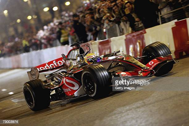 Lewis Hamilton of Great Britain drives the Vodafone McLaren Mercedes on the streets during the launch of the Vodafone McLaren Mercedes 2007 MP422 F1...