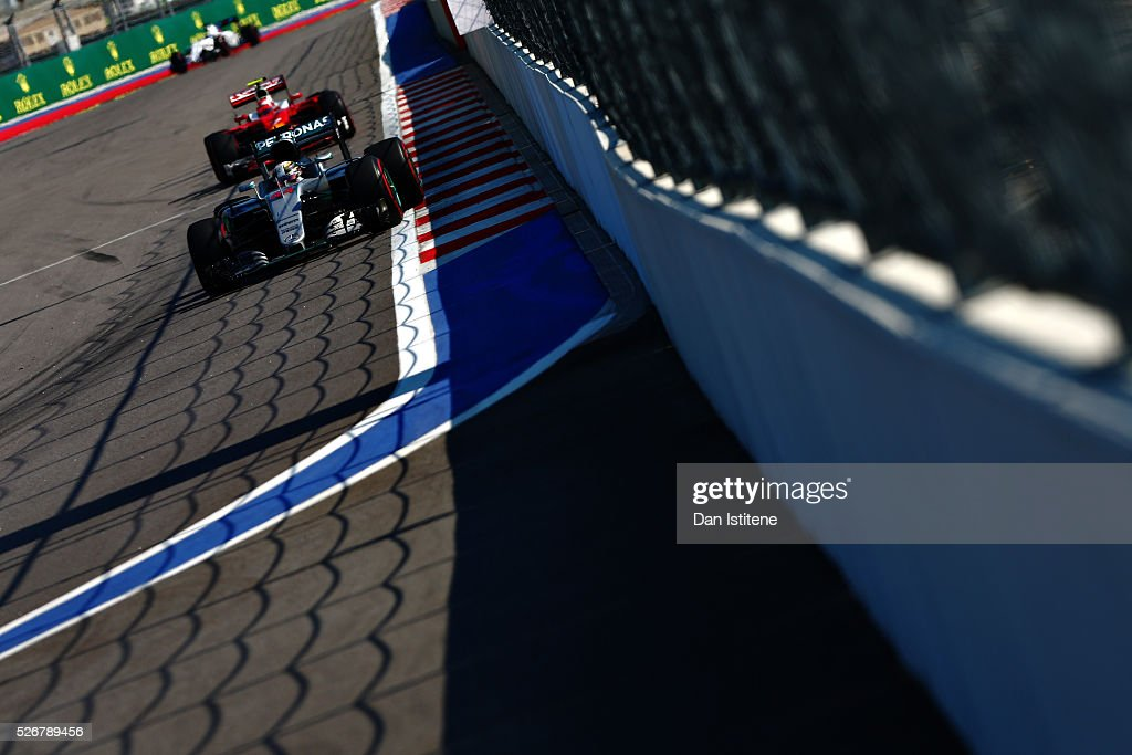 <a gi-track='captionPersonalityLinkClicked' href=/galleries/search?phrase=Lewis+Hamilton&family=editorial&specificpeople=586983 ng-click='$event.stopPropagation()'>Lewis Hamilton</a> of Great Britain driving the (44) Mercedes AMG Petronas F1 Team Mercedes F1 WO7 Mercedes PU106C Hybrid turbo on track ahead of <a gi-track='captionPersonalityLinkClicked' href=/galleries/search?phrase=Kimi+Raikkonen&family=editorial&specificpeople=201904 ng-click='$event.stopPropagation()'>Kimi Raikkonen</a> of Finland driving the (7) Scuderia Ferrari SF16-H Ferrari 059/5 turbo (Shell GP) during the Formula One Grand Prix of Russia at Sochi Autodrom on May 1, 2016 in Sochi, Russia.