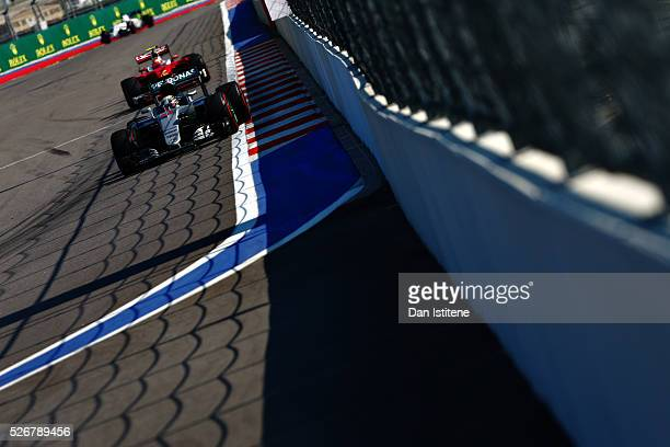 Lewis Hamilton of Great Britain driving the Mercedes AMG Petronas F1 Team Mercedes F1 WO7 Mercedes PU106C Hybrid turbo on track ahead of Kimi...