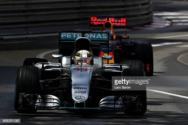Lewis Hamilton of Great Britain driving the Mercedes AMG Petronas F1 Team Mercedes F1 WO7 Mercedes PU106C Hybrid turbo leads Daniel Ricciardo of...