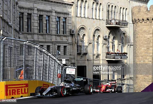 Lewis Hamilton of Great Britain driving the Mercedes AMG Petronas F1 Team Mercedes F1 WO7 Mercedes PU106C Hybrid turbo and Sebastian Vettel of...