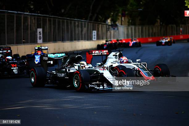 Lewis Hamilton of Great Britain driving the Mercedes AMG Petronas F1 Team Mercedes F1 WO7 Mercedes PU106C Hybrid turbo battles with Romain Grosjean...