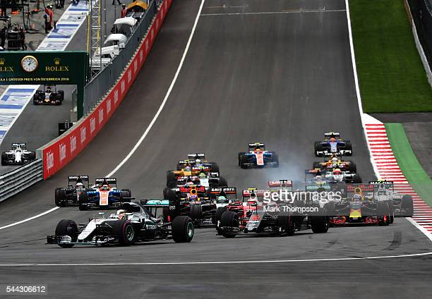 Lewis Hamilton of Great Britain driving the Mercedes AMG Petronas F1 Team Mercedes F1 WO7 Mercedes PU106C Hybrid turbo leads at the start of the race...