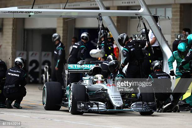 Lewis Hamilton of Great Britain driving the Mercedes AMG Petronas F1 Team Mercedes F1 WO7 Mercedes PU106C Hybrid turbo makes a pit stop for new tyres...