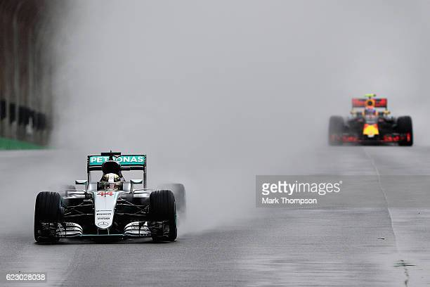 Lewis Hamilton of Great Britain driving the Mercedes AMG Petronas F1 Team Mercedes F1 WO7 Mercedes PU106C Hybrid turbo leads Max Verstappen of the...