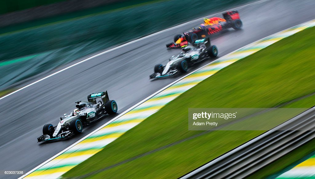 Lewis Hamilton of Great Britain driving the (44) Mercedes AMG Petronas F1 Team Mercedes F1 WO7 Mercedes PU106C Hybrid turbo leads Nico Rosberg of Germany driving the (6) Mercedes AMG Petronas F1 Team Mercedes F1 WO7 Mercedes PU106C Hybrid turbo and Max Verstappen of the Netherlands driving the (33) Red Bull Racing Red Bull-TAG Heuer RB12 TAG Heuer on track during the Formula One Grand Prix of Brazil at Autodromo Jose Carlos Pace on November 13, 2016 in Sao Paulo, Brazil.