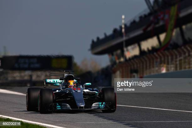Lewis Hamilton of Great Britain driving the Mercedes AMG Petronas F1 Team Mercedes F1 WO8 leaves the pits during day three of Formula One winter...