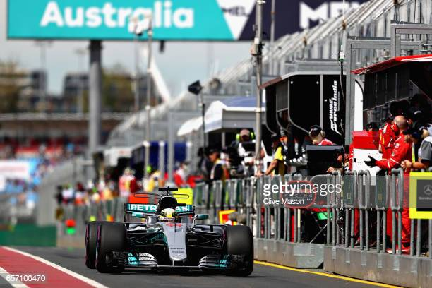 Lewis Hamilton of Great Britain driving the Mercedes AMG Petronas F1 Team Mercedes F1 WO8 in the Pitlane during practice for the Australian Formula...