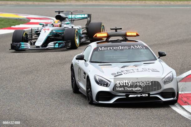 Lewis Hamilton of Great Britain driving the Mercedes AMG Petronas F1 Team Mercedes F1 WO8 follows the safety car on track during the Formula One...