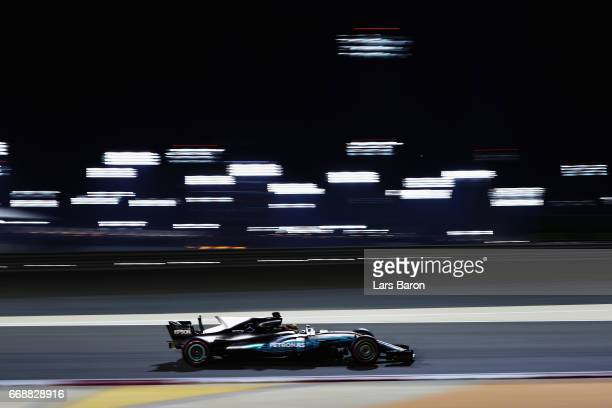 Lewis Hamilton of Great Britain driving the Mercedes AMG Petronas F1 Team Mercedes F1 WO8 on track during qualifying for the Bahrain Formula One...
