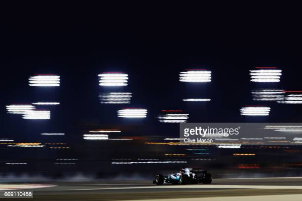 Lewis Hamilton of Great Britain driving the Mercedes AMG Petronas F1 Team Mercedes F1 WO8 on track during the Bahrain Formula One Grand Prix at...