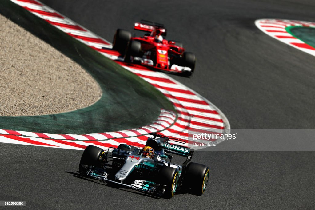 Lewis Hamilton of Great Britain driving the (44) Mercedes AMG Petronas F1 Team Mercedes F1 WO8 leads Sebastian Vettel of Germany driving the (5) Scuderia Ferrari SF70H on track during qualifying for the Spanish Formula One Grand Prix at Circuit de Catalunya on May 13, 2017 in Montmelo, Spain.