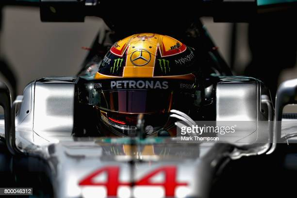 Lewis Hamilton of Great Britain driving the Mercedes AMG Petronas F1 Team Mercedes F1 WO8 in the Pitlane during practice for the European Formula One...