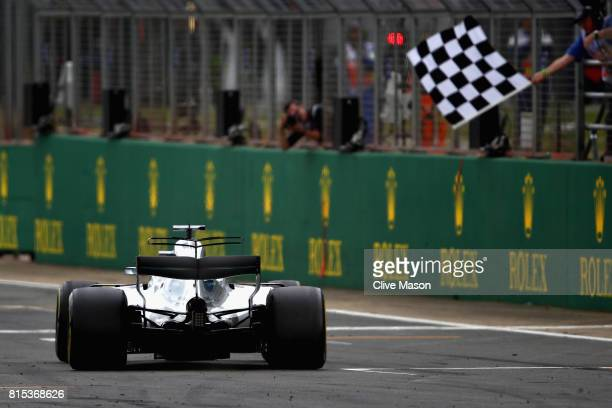 Lewis Hamilton of Great Britain driving the Mercedes AMG Petronas F1 Team Mercedes F1 WO8 takes the chequered flag and the win during the Formula One...