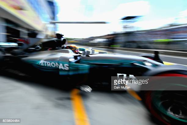 Lewis Hamilton of Great Britain driving the Mercedes AMG Petronas F1 Team Mercedes F1 WO8 leaves the garage during practice for the Formula One Grand...