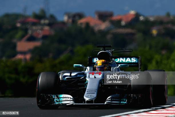 Lewis Hamilton of Great Britain driving the Mercedes AMG Petronas F1 Team Mercedes F1 WO8 on track during the Formula One Grand Prix of Hungary at...