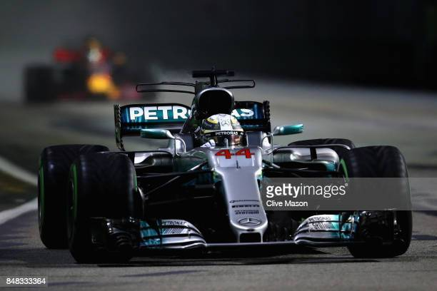 Lewis Hamilton of Great Britain driving the Mercedes AMG Petronas F1 Team Mercedes F1 WO8 on track during the Formula One Grand Prix of Singapore at...