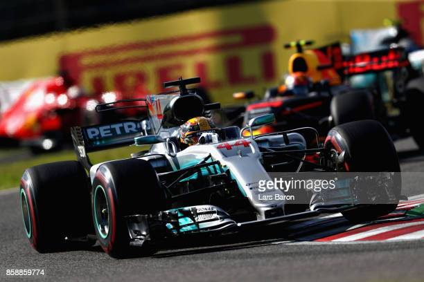 Lewis Hamilton of Great Britain driving the Mercedes AMG Petronas F1 Team Mercedes F1 WO8 on track during the Formula One Grand Prix of Japan at...