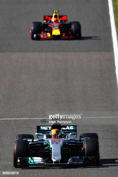 Lewis Hamilton of Great Britain driving the Mercedes AMG Petronas F1 Team Mercedes F1 WO8 leads Max Verstappen of the Netherlands driving the Red...