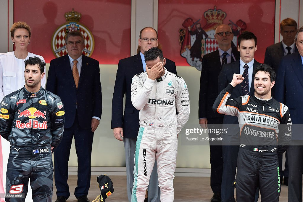 <a gi-track='captionPersonalityLinkClicked' href=/galleries/search?phrase=Lewis+Hamilton&family=editorial&specificpeople=586983 ng-click='$event.stopPropagation()'>Lewis Hamilton</a> of Great Britain gestures on the podium after winning the F1 Grand Prix of Monaco, as <a gi-track='captionPersonalityLinkClicked' href=/galleries/search?phrase=Daniel+Ricciardo&family=editorial&specificpeople=6547569 ng-click='$event.stopPropagation()'>Daniel Ricciardo</a> of Australia (L) and Sergio Perez of Mexico (R) stand on May 29, 2016 in Monte-Carlo, Monaco.