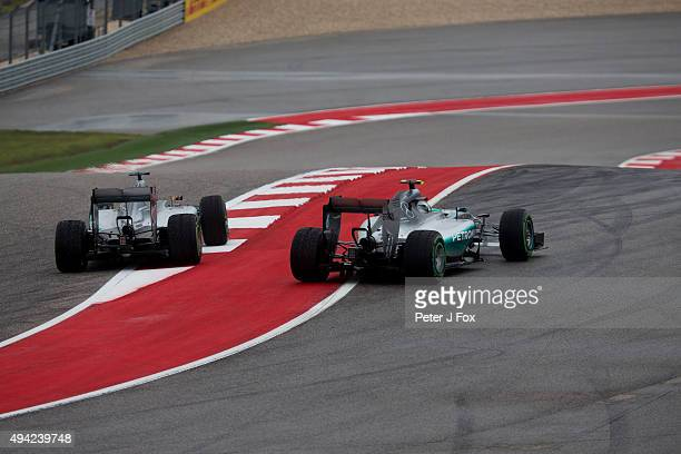 Lewis Hamilton of Great Britain overtakes Nico Rosberg of Germany both of Mercedes at the start during the United States Formula One Grand Prix at...