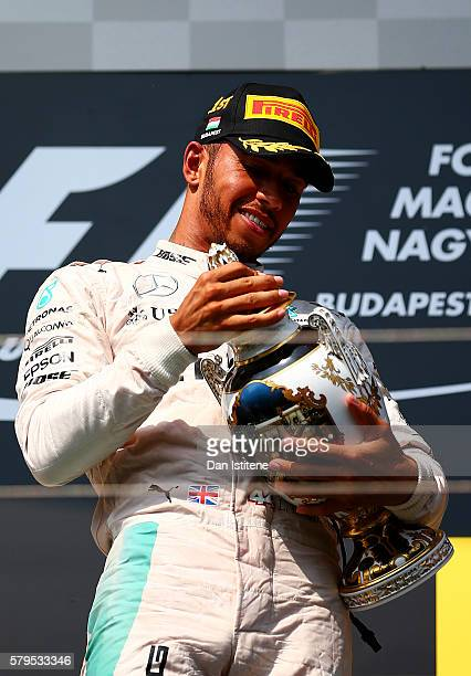 Lewis Hamilton of Greatc Britain and Mercedes GP lifts the trophy on the podium after winning the Formula One Grand Prix of Hungary at Hungaroring on...