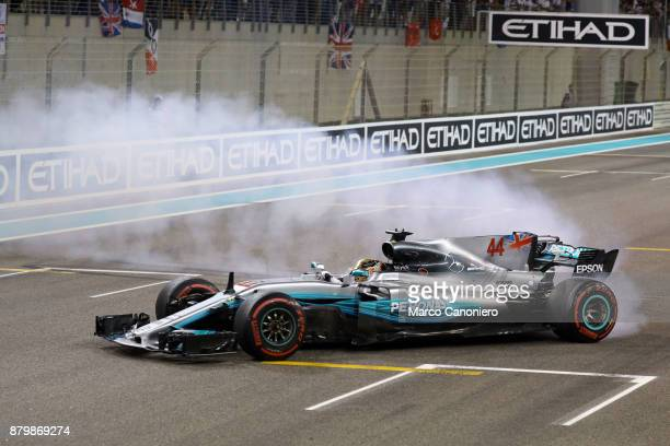 Lewis Hamilton of Mercedes AMG Petronas F1 Team celebrates with donuts on track during the Abu Dhabi Formula One Grand Prix