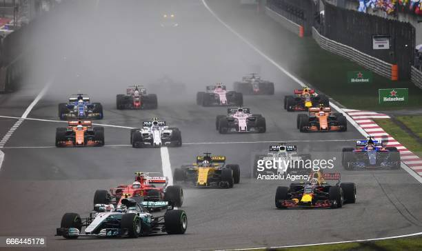 Lewis Hamilton of Mercedes AMG Petronas F1 Team leads the field into turn 1 at the start during the Formula One Grand Prix of China at Shanghai...