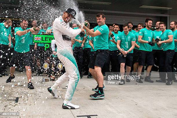 Lewis Hamilton of Mercedes and Great Britain celebrates with the team during the Formula One Grand Prix of Russia at Sochi Autodrom on October 11...