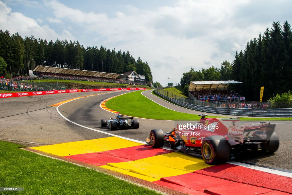 Lewis Hamilton of Mercedes and Great Britain leads Sebastian Vettel of Ferrari and Germany at the restart during the Formula One Grand Prix of Belgium at Circuit de Spa-Francorchamps on August 27, 2017 in Spa, Belgium.