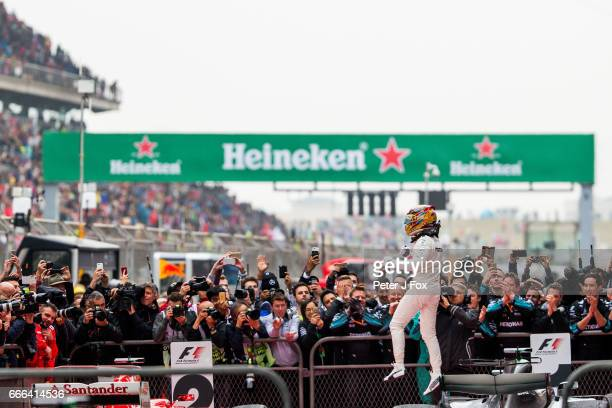 Lewis Hamilton of Mercedes and Great Britain wins the Formula One Grand Prix of China at Shanghai International Circuit on April 9 2017 in Shanghai...