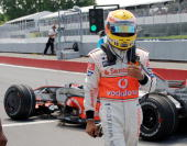 Lewis Hamilton of the United Kingdom driving for Vodafone McLaren Mercedes walks away from his car after colliding with Kimi Raikkonen of Finland...