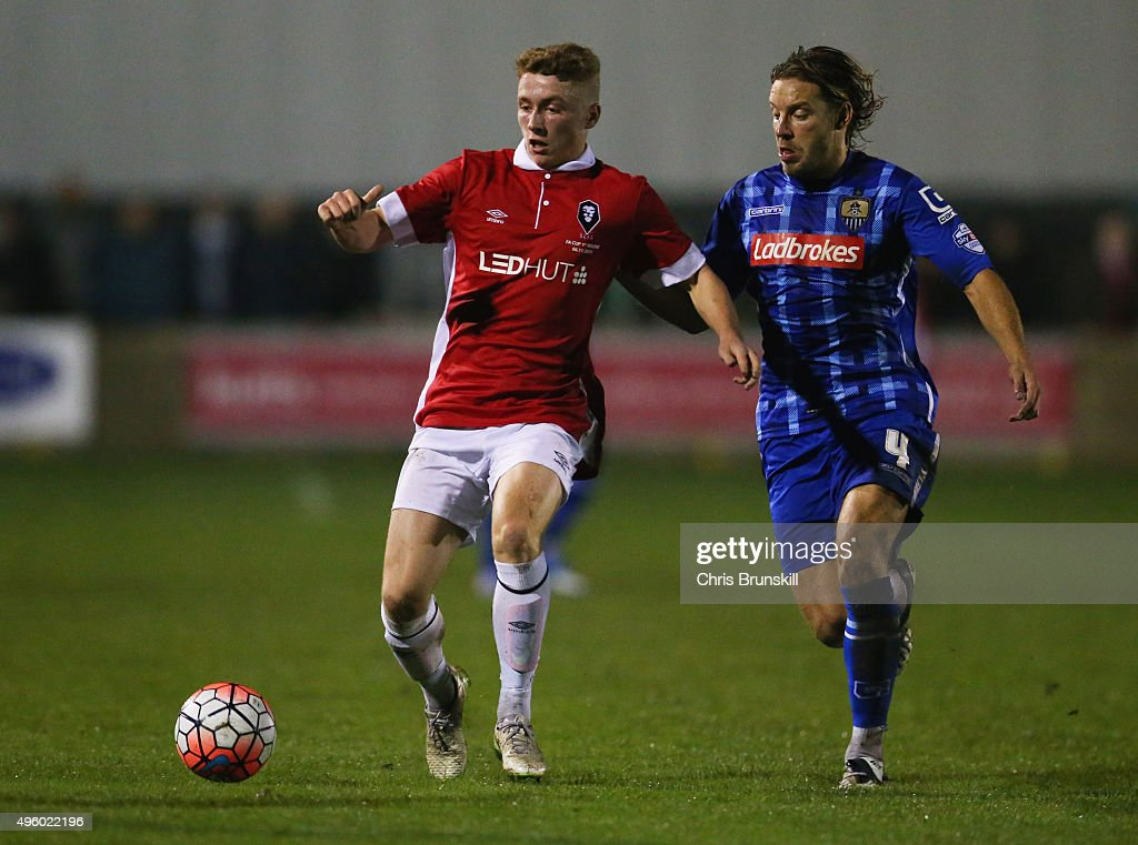 Lewis Hardcastle of Salford City holds off Alan Smith of Notts County during the Emirates FA Cup first round match between Salford City and Notts...