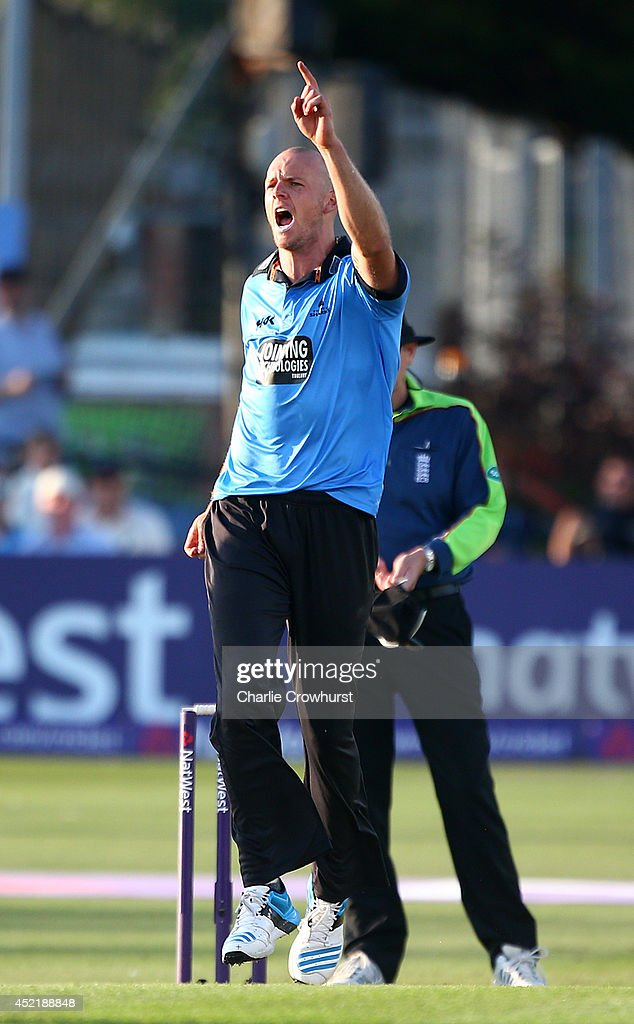 Lewis Hatchett of Sussex celebrates after bowling out Ben Wright of Glamorgan during the Natwest T20 Blast match between Sussex Sharks and Glamorgan at The BrightonAndHoveJobs.com County Ground on July 15, 2014 in Hove, England.