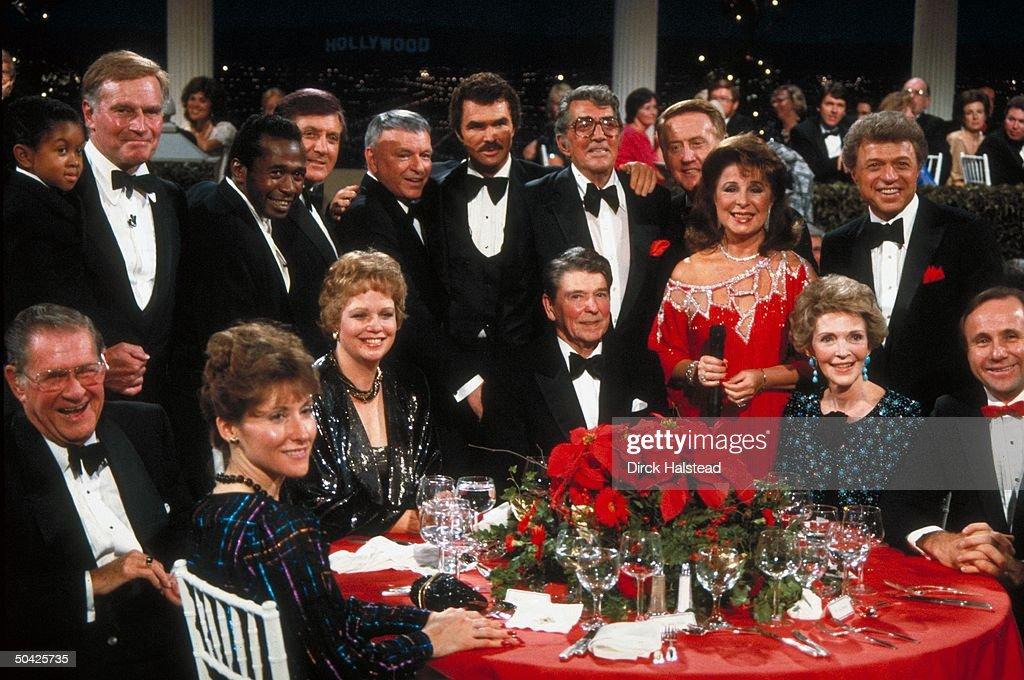Lewis Heston Vereen Hall Sinatra Reynolds Martin Lawrence Gorme at table Maureen Ron Nancy Michael Reagan at fete honoring Reagan
