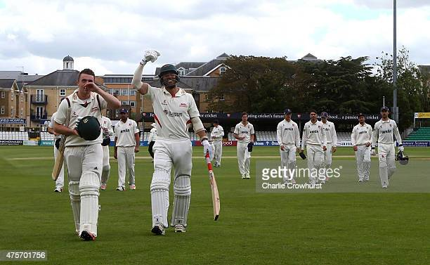 Lewis Hill and Andrea Agathangelou of Leicestershire celebrate the teams win as they leave the pitch during day four of the LV County Championship...