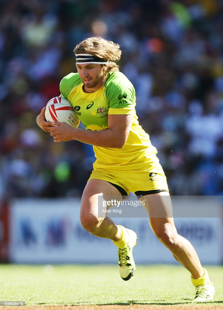 Lewis Holland of Australia runs with the ball during the 2016 Sydney Sevens Cup Semi Final match between Australia and South Africa at Allianz Stadium on February 7, 2016 in Sydney, Australia.