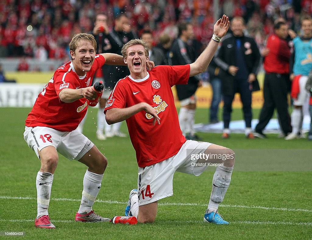 <a gi-track='captionPersonalityLinkClicked' href=/galleries/search?phrase=Lewis+Holtby&family=editorial&specificpeople=5351202 ng-click='$event.stopPropagation()'>Lewis Holtby</a> and André Schuerrle of Mainz (R) celebrate the 4-2 victory after the Bundesliga match between FSV Mainz 05 and 1899 Hoffenheim at Bruchweg Stadium on October 2, 2010 in Mainz, Germany.