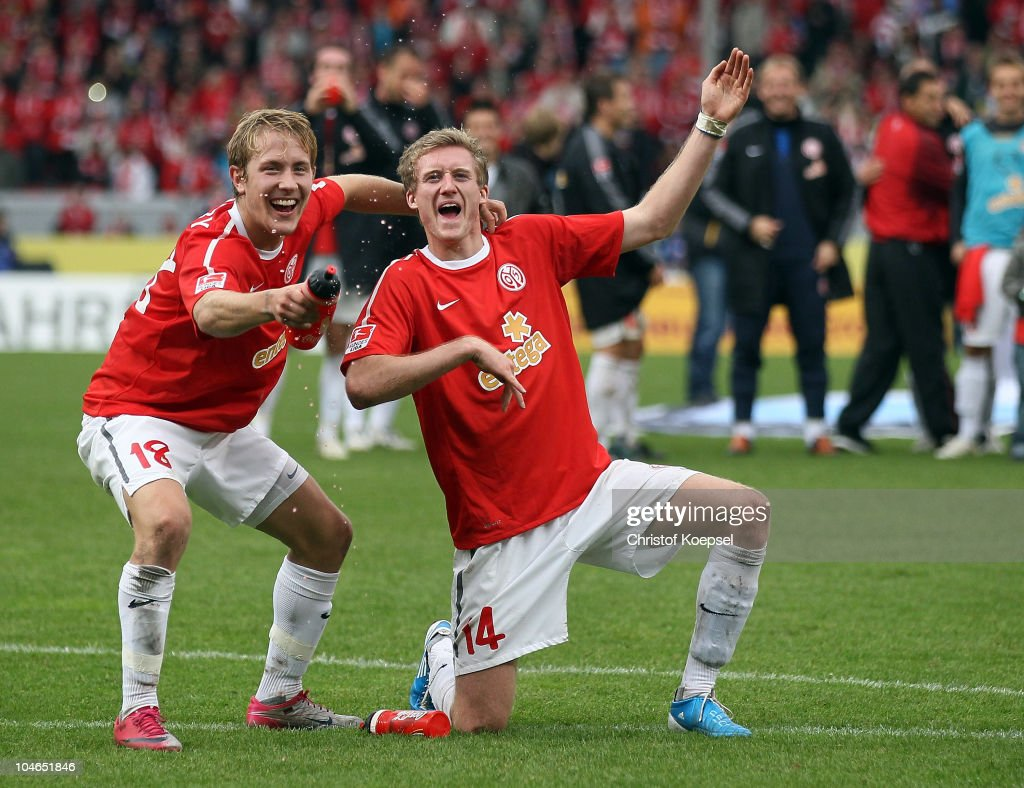 Lewis Holtby and André Schuerrle of Mainz (R) celebrate the 4-2 victory after the Bundesliga match between FSV Mainz 05 and 1899 Hoffenheim at Bruchweg Stadium on October 2, 2010 in Mainz, Germany.