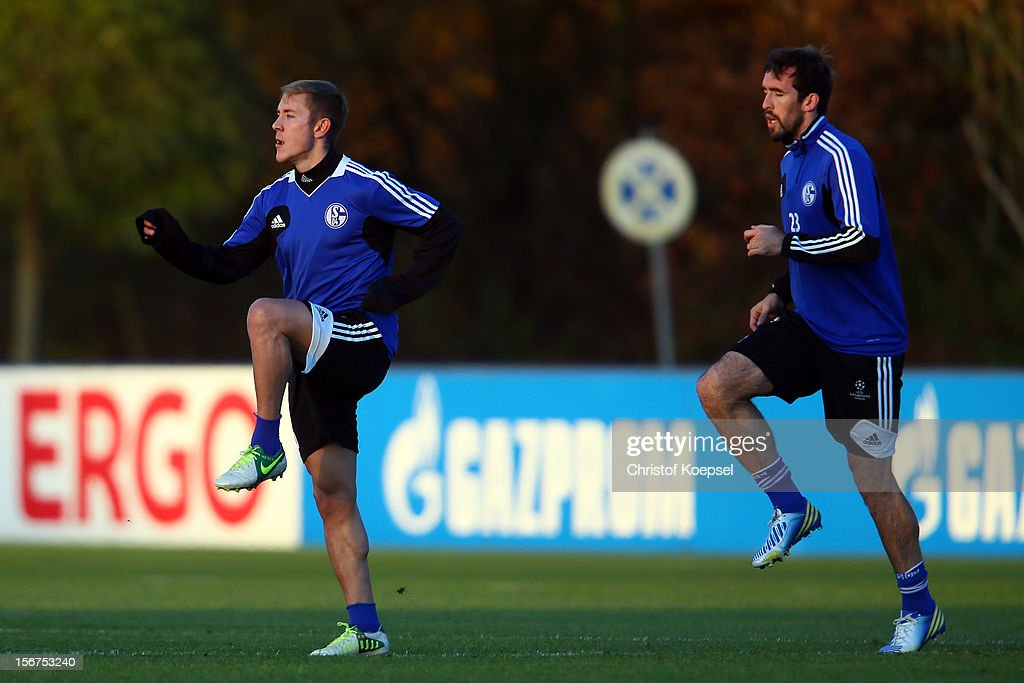 Lewis Holtby and Christian Fuchs of Schalke 04 attend the training session at the training ground ahead of the UEFA Champions League group B match between FC Schalke 04 and Olympiakos Piraeus on November 21, 2012 in Gelsenkirchen, Germany.