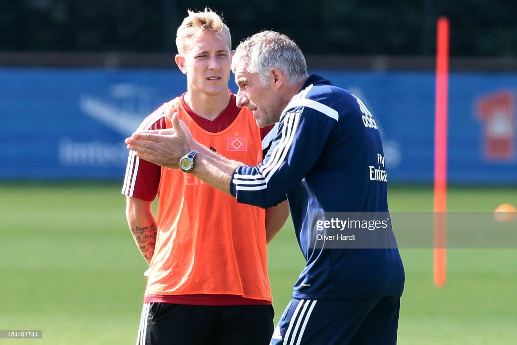 <a gi-track='captionPersonalityLinkClicked' href=/galleries/search?phrase=Lewis+Holtby&family=editorial&specificpeople=5351202 ng-click='$event.stopPropagation()'>Lewis Holtby</a> and Head coach <a gi-track='captionPersonalityLinkClicked' href=/galleries/search?phrase=Mirko+Slomka&family=editorial&specificpeople=874525 ng-click='$event.stopPropagation()'>Mirko Slomka</a> of Hamburg talks during the training session of Hamburger SV on September 2, 2014 in Hamburg, Germany.