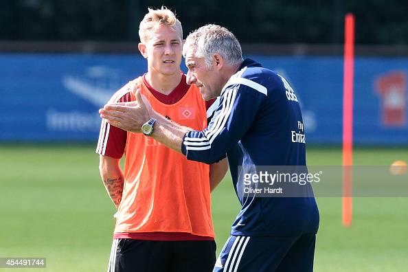 Lewis Holtby and Head coach Mirko Slomka of Hamburg talks during the training session of Hamburger SV on September 2 2014 in Hamburg Germany