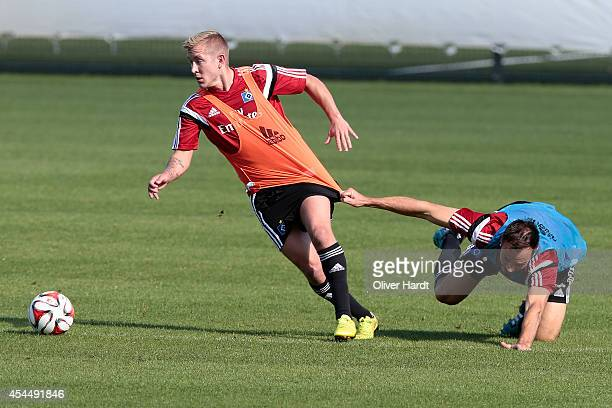 Lewis Holtby and Heiko Westermann of Hamburg compete for the ball during the training session of Hamburger SV on September 2 2014 in Hamburg Germany