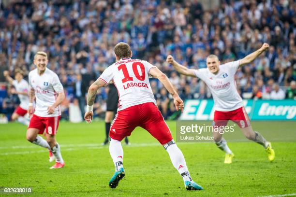 Lewis Holtby and Kyriakos Papadopulos of Hamburg celebrate the goal of PierreMichel Lasogga of Hamburg during the Bundesliga match between FC Schalke...