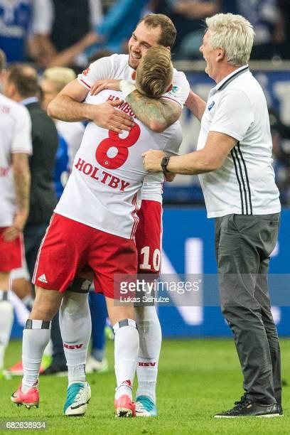 Lewis Holtby and PierreMichel Lasogga celebrate after the Bundesliga match between FC Schalke 04 and Hamburger SV at VeltinsArena on May 13 2017 in...