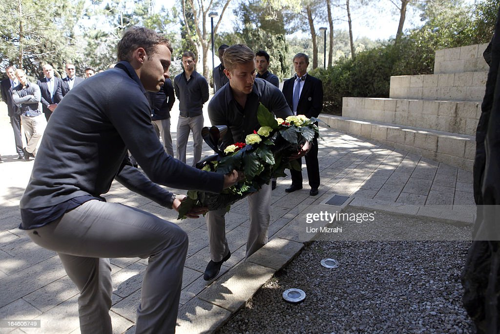 Lewis Holtby and Toni Jantschke of the U21 Germany football team lay a wreath during the visit of Yad Vashem on March 25, 2013 in Jerusalem, Israel. Yad Vashem is Israel's official memorial to the Jewish victims of the Holocaust.
